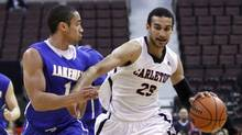 Carleton Ravens' Philip Scrubb, right, drives past Lakehead Thunderwolves' Ben Johnson during gold medal final play at the Canadian Interuniversity Sport Basketball Final 8 in Ottawa on Sunday, March 10, 2013. (The Canadian Press)