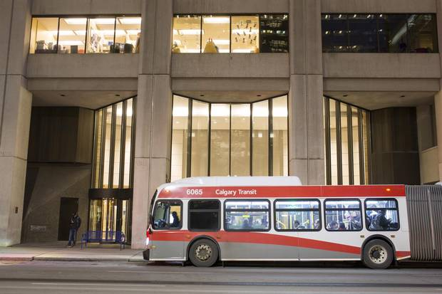 A bus collects workers for the ride home from Calgary's financial district this week. There is no shortage of empty seats.
