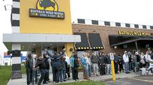 Wing fans brave the overnight rain for a chance to be the first in Canada to taste Buffalo Wild Wings, May 16, 2011, in Oshawa. (Salvatore Sacco/Buffalo Wild Wings)