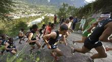 Participants climb the hill during the 38th Sierre-Zinal Long Distance Mountain Running Championsship in Sierre, Switzerland, Sunday, Aug. 14, 2011. (Laurent Gillieron/The Associated Press)
