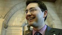 Conservative MP Pierre Poilievre laughs in the foyer of the House of Commons after Question Period on Feb. 27, 2007. (CHRIS WATTIE)