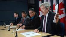 NDP MP Charlie Angus, right, speaks during a press conference in Ottawa on July 29, 2013, beside Edmund Metatawabin, former chief of the Fort Albany First Nation. (SEAN KILPATRICK/THE CANADIAN PRESS)