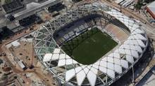 FILE - This Dec. 10, 2013 file photo shows an aerial view of the Arena da Amazonia stadium in Manaus, Brazil. A worker was injured in an accident outside this World Cup stadium, local organizers said Friday, Feb. 7, 2014. (Renata Brito/AP)