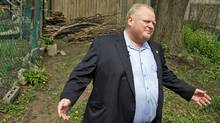 Toronto Mayor Rob Ford shows reporters the land in the public park behind his house on May 3, 2012. (Fernando Morales/Fernando Morales/The Globe and Mail)