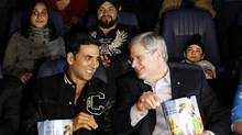 "Prime Minister Stephen Harper talks with Bollywood actor Akshay Kumar before the start of the Canadian premiere of the film ""Thank You"" in April. (CHRIS WATTIE/REUTERS)"