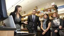 Dr. Crystal Chan explains her research to Jeff Rosenthal, Laurel Linetsky-Fleisher and Karen Cohen. (Matthew Sherwood for The Globe and Mail/Matthew Sherwood for The Globe and Mail)