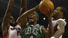 Boston Celtics' Marquis Daniels drives to the basket as Toronto Raptors' Amir Johnson (left) and Rasual Butler (right) defend during first half NBA play in Toronto on Friday February 10, 2012. THE CANADIAN PRESS/Pawel Dwulit (Pawel Dwulit/CP)
