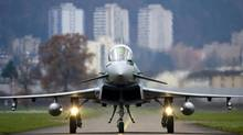 An EADS Eurofighter Typhoon at the Swiss air base in Emmen, central Switzerland. There was some industrial logic to the merger of Britain's BAE and Franco-German EADS – the launch of a formidable rival to America's Boeing – but the merger was doomed the moment it was conceived and it was euthanized on Wednesday. (MICHAEL BUHOLZER/REUTERS)