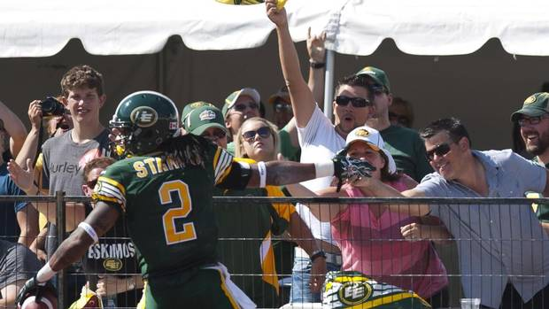 Edmonton Eskimos fans congratulate Fred Stamps on his touchdown during first half CFL football game action against the Saskatchewan Roughriders, in Edmonton, Alta., on Saturday, August 24, 2013. (JOHN ULAN/THE CANADIAN PRESS)
