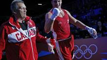 Simon Kean of Canada (R) reacts after he defeated France's Tony Yoka fight in their Men's Super Heavy (+91kg) Round of 16 boxing match at the London 2012 Olympic Games August 1, 2012. (MURAD SEZER/REUTERS)