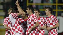 Croatian's Nikola Kalinic (14) celebrates with teammates during their friendly soccer match against Estonia at Aldo Drosina Stadium in Pula May 25, 2012 (ANTONIO BRONIC/Reuters)