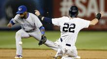 New York's' Jacoby Ellsbury steals a base as Toronto's Jose Reyes fields a late throw Thursday. (Kathy Willens/AP)