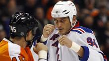 Derek Boogaard fight sduring an NHL hockey game in Philadelphia. (Matt Slocum/AP)