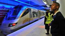 The high-speed Gautrain, in which Bombardier is a leading partner, is a $3.7-billion 80-kilometre project to link Johannesburg and Pretoria and the country's main international airport. The rail line has been shut down twice by thieves who stole cables. (ALEXANDER JOE/ALEXANDER JOE/AFP/GETTY IMAGES)