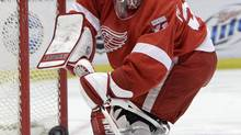 Detroit Red Wings goalie Joey MacDonald (31) passes the puck during the first period of an NHL game against the Edmonton Oilers in Detroit, Wednesday, Feb. 8, 2012. (Carlos Osorio/AP)