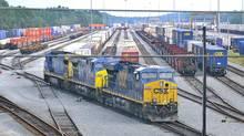 A CSX locomotive makes its way out of a rail yard depot in Jacksonville, Fla. (Lori Moffett/Bloomberg)