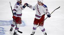 New York Rangers forward Brad Richards, left, celebrates with teammate Ryan McDonagh after he scored a goal against the Montreal Canadiens during the third period in Game 1 of the Eastern Conference Finals of the 2014 Stanley Cup Playoffs at the Bell Centre. (Eric Bolte/USA Today Sports)
