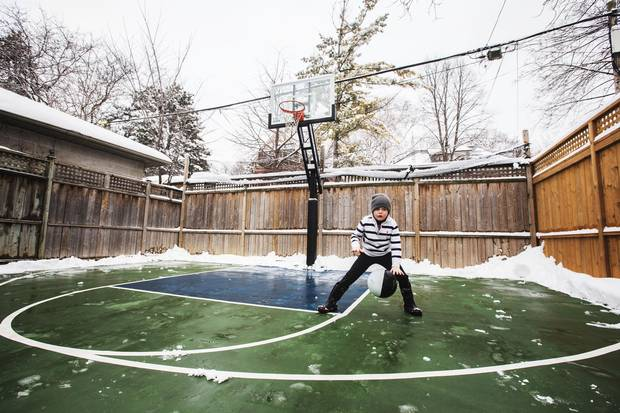 Leo Schofield-Fitzpatrick plays basketball in the backyard of his Parkdale home in Toronto on February 12, 2017.