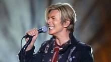 David Bowie performs at Rexall Place in Edmonton, Alta., Friday April 9, 2004. (Darryl Dyck/CP)