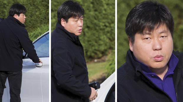 Kenny Gu enters his car outside of his home in West Vancouver, B.C., on Sept. 1, 2016.