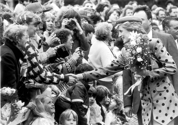 Diana, The Princess of Wales shakes hands with a girl in the crowd at the Legislature Buildings in Victoria, B.C.