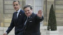 Bank of Canada Governor Mark Carney, left, and Finance Minister Jim Flaherty (FRED DUFOUR/AFP/Getty Images)