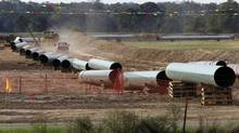 The construction of the southern leg of the Keystone pipeline in Sumner, Tex. (TONY GUTIERREZ/AP)