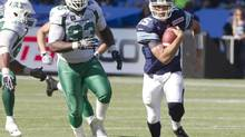 Toronto Argonauts quarterback Ricky Ray scrambles for a first down in the fourth quarter of their CFL game against the Saskatchewan Roughriders in Toronto on Saturday, July 5, 2014. (FRED THORNHILL/THE CANADIAN PRESS)