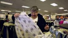 FILE--Ruth Wilson shops for clothes at Fashion Bug Plus in Bristol, Pa. Thursday, Jan. 25, 2001. Charming Shoppes, which runs 1,789 stores in 48 states has been purchased by Ascena Retail Group. (DAN LOH/AP)