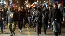 Protesters opposing tuition-fee hikes demonstrate in Montreal on Saturday night. (Graham Hughes/The Canadian Press)