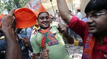 Supporters of the India's Bharatiya Janata Party (BJP) celebrate after learning of the poll results outside the party headquarters in New Delhi May 16, 2014. (ADNAN ABIDI/REUTERS)