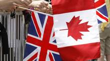 Diplomats and officials are scurrying to ship flagpoles to far-flung embassies – an estimated $2,400 plus freight to fly the Maple Leaf in Baghdad – so that neither country gets caught with its flag down again. (ADRIAN WYLD/THE CANADIAN PRESS)