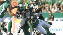 Edmonton Eskimos quarterback Steven Jyles (3) gets sacked by Saskatchewan Roughriders defensive end Brent Hawkins during second half CFL game in Regina, Saskatchewan July 8, 2012. (DAVID STOBBE/REUTERS)