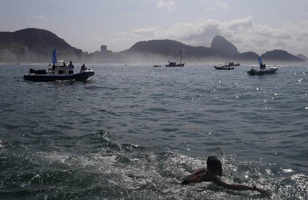 Richard Weinberger of Canada takes part in the international marathon swimming event in Copacabana in Rio de Janeiro, Brazil, last summer. Triathletes will be swimming the polluted waters at the Olympics this summer.