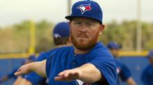 Toronto Blue Jays pitcher Jesse Litsch warms up on the first official day of the team's Spring Training in Dunedin, Fla. on Wednesday February 22, 2012. (The Canadian Press)