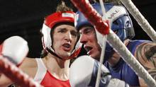 Liberal MP Justin Trudeau, left, fights Conservative Senator Patrick Brazeau during charity boxing match for cancer research Saturday, March 31, 2012 in Ottawa (FRED CHARTRAND/FRED CHARTRAND / CP)