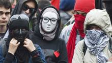 Masked protesters take part in an anti-capitalist demonstration in Montreal, Tuesday, May 1, 2012. (The Canadian Press/Graham Hughes)