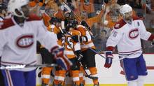 Philadelphia Flyers, center, celebrate a goal by Arron Asham as Montreal Canadiens' P.K. Subban, left, and Hal Gill skate by in the second period of Game 5 of the NHL hockey Eastern Conference finals, Monday, May 24, 2010, in Philadelphia. (Matt Slocum/AP)