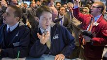 Traders work on the floor of the New York Stock Exchange March 21, 2014. (LUCAS JACKSON/REUTERS)