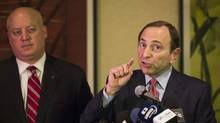 National Hockey League (NHL) Commissioner Gary Bettman gestures in front of NHL deputy commissioner Bill Daly (L) as he describes negotiations between the NHL and the NHL Players Association regarding the difficulties of their current labour talks in New York, December 6, 2012. The National Hockey League Players' Association (NHLPA) said the league rejected its latest offer on Thursday as labor talks aimed at ending the lockout unexpectedly broke off on Thursday. (LUCAS JACKSON/REUTERS)