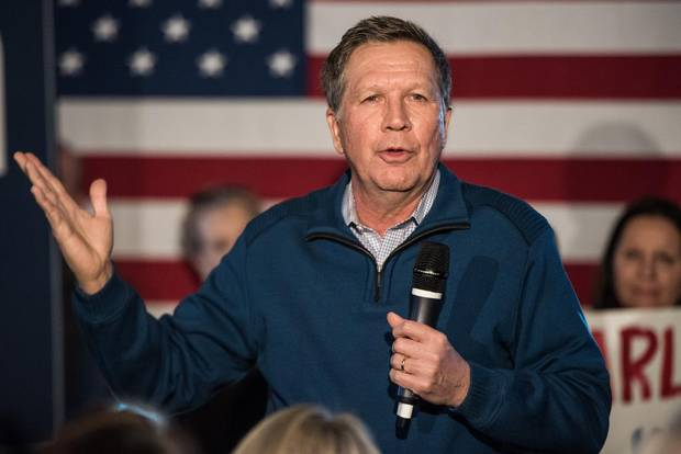 Republican presidential candidate Ohio Governor John Kasich talks to the crowd at Finn's Brick Oven Pizzaduring a campaign stop on February 10, 2016 in Mt. Pleasant, South Carolina. The South Carolina Republican primary will be held February 20, 2016.
