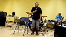 Leo (Kallu Nangmalik, 50) speaks to the people gathered in the community center in Repulse Bay, Nunavut (on the Arctic Circle) on the evening of November 13, 2010. Following a day of group therapy by a men's support group, they held a healing service open to all members of the community in the Community Centre. There were prayers, music and tears as men shared their pain openly and made amends with family members, and people came forward to be healed. (Peter Power/The Globe and Mail)