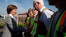 B.C. Liberal Leader Christy Clark greets workers during a campaign stop at Port Metro Vancouver on May 10, 2013. (Darryl Dyck/The Canadian Press)