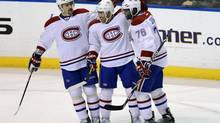 Montreal Canadiens' Francis Bouillon, centre, Tomas Plekanec, left, and P.K.Subban celebrate Bouillon's goal against the Florida Panthers during the second period of their NHL hockey game in Sunrise, Florida March
