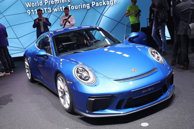 FRANKFURT AM MAIN, GERMANY - SEPTEMBER 12: Visitors look at the new Porsche 911 GT3 at the 2017 Frankfurt Auto Show on September 12, 2017 in Frankfurt am Main, Germany. The Frankfurt Auto Show is taking place during a turbulent period for the auto industry. Leading companies have been rocked by the self-inflicted diesel emissions scandal. At the same time the industry is on the verge of a new era as automakers commit themselves more and more to a future that will one day be dominated by electric cars.
