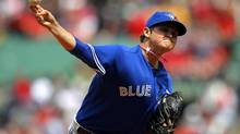 The Toronto Blue Jays' Chad Jenkins pitches against the Boston Red Sox in the first inning of their MLB American League baseball game at Fenway Park in Boston, Massachusetts May 12, 2013. (BRIAN SNYDER/REUTERS)
