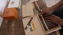 A man packs a box of black-market cigars in Havana. (ENRIQUE DE LA OSA/REUTERS)