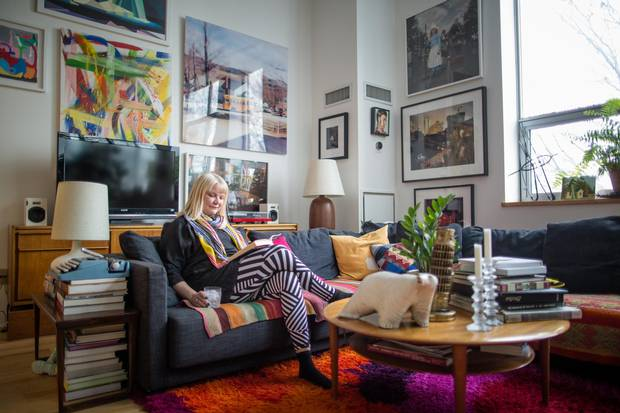 Sarah Keenleyside enjoys the living room of her loft appartment in Toronto's Kensington Market.