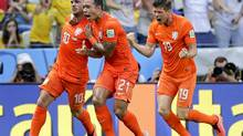 Netherlands' Wesley Sneijder, left, celebrates with teammates Memphis Depay and Klaas-Jan Huntelaar after scoring his side's first goal during the World Cup round of 16 soccer match between the Netherlands and Mexico at the Arena Castelao in Fortaleza, Brazil on June 29. (Felipe Dana/AP)