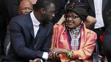 Winnie Mandela greets British actor Idris Elba at the Johannesburg premier of Mandela: Long Walk to Freedom. (SIPHIWE SIBEKO/REUTERS)